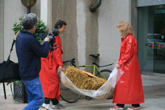 Tracy Worcester, the Marchioness of Worcester and film maker and Stephanie Brown, Canadian Coalition for Farm Animals delivered a bale of straw to the CEO of Maple Leaf , Michael McCain outside Maple Leaf Foods Inc., on Wednesday, June 16, 2010.